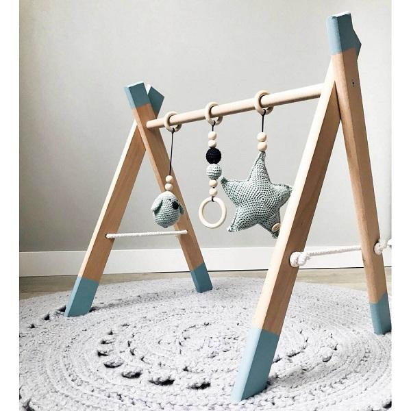 Unieke handgemaakte houten babygym die je zelf kunt samenstellen